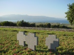 Stone crosses on the hillside among the graves at Maleme